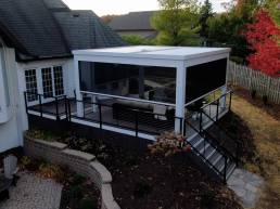 White Struxure with Black panel shades on dark deck