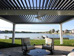 lake view covered patio with struxure and overhead fan