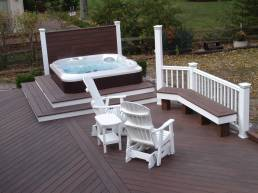 simple hot tub design on outdoor deck with dark wood