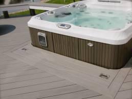 hot tub on light wood deck