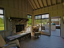 Custom three season room with stone fireplace