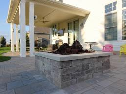 square stone fire pit with lava rock
