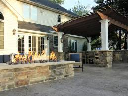 stone patio inspiration with rectangle fire pit