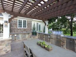 outdoor dining room dark wood pergola