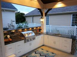 Outdoor kitchen with built in cabinets and grill
