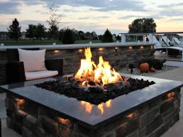outdoor dark stone fire pit