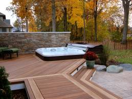 premium custom stained deck with 6 person tub