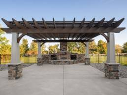 stationary pergola and fire place with mixed brick