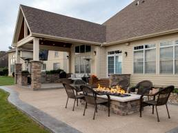 rectangular stone fire pit with covered porch