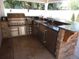 Stainless steel outdoor kitchen with stone