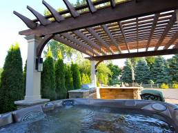 dark wood stationary pergola over hot tub